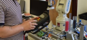 EM Student Programming a Robot